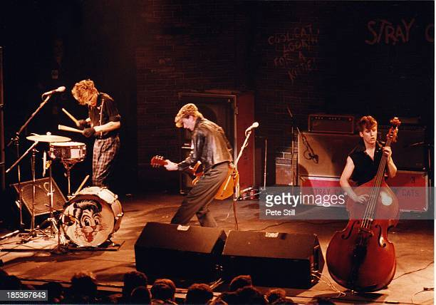 Slim Jim Phantom Brian Setzer and Lee Rocker of The Stray Cats perform on stage at the Lyceum Theatre in the Strand on March 23rd 1981 in London...