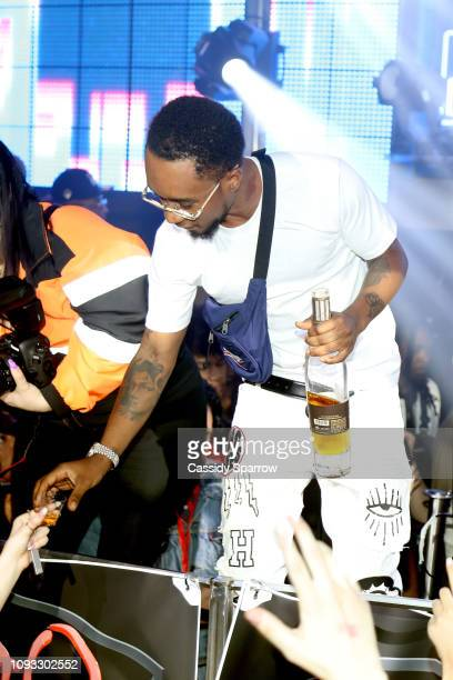 Slim Jxmmi pours drinks for guest during TAO Group's Big Game Takeover presented by Tongue Groove on February 2 2019 in Atlanta Georgia