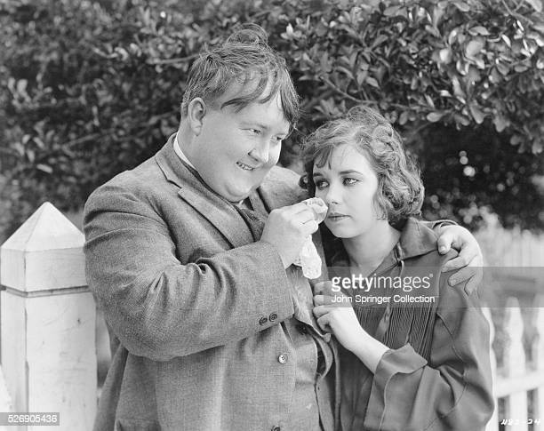 Slim Swasey dries the tears of Ollie Remus in a scene from the 1924 film Fair Week