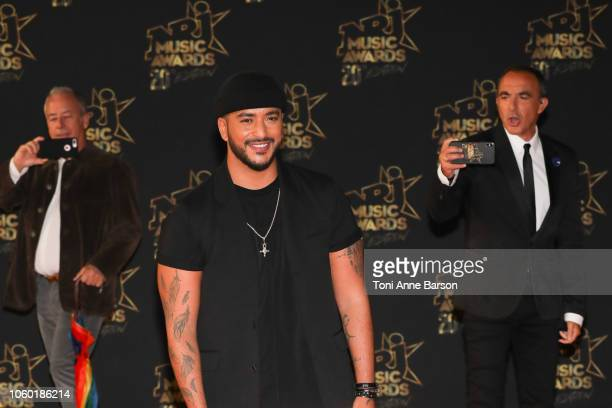 Slimane and Nikos Aliagas attend the '20th NRJ Music Awards' at Palais des Festivals on November 10 2018 in Cannes France