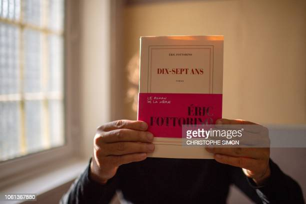 Slimane poses with his chosen book Dixsept ans by French writer and journalist Eric Fottorino at the penitentiary of SalondeProvence southern France...