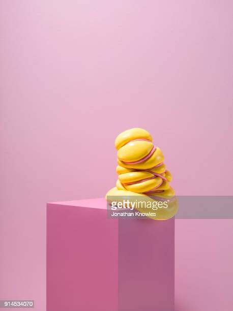 slime tied with rope balancing on plinth - pedestal stock pictures, royalty-free photos & images