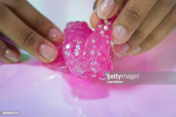 slime toy - slimy stock pictures, royalty-free photos & images