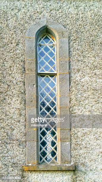 slim-line, cast-iron church window - stone material stock pictures, royalty-free photos & images