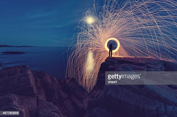 slinging the sparks - concentric stock pictures, royalty-free photos & images