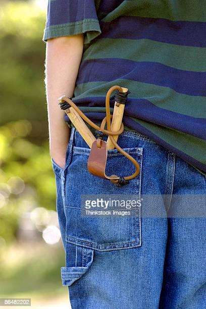 Slingshot in boy's back pocket