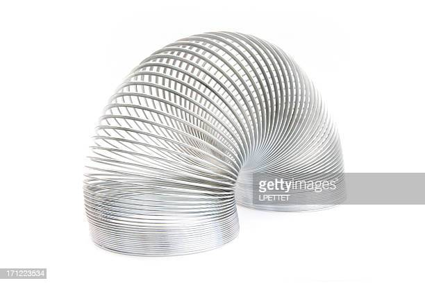 slinky spring - metal coil toy stock photos and pictures