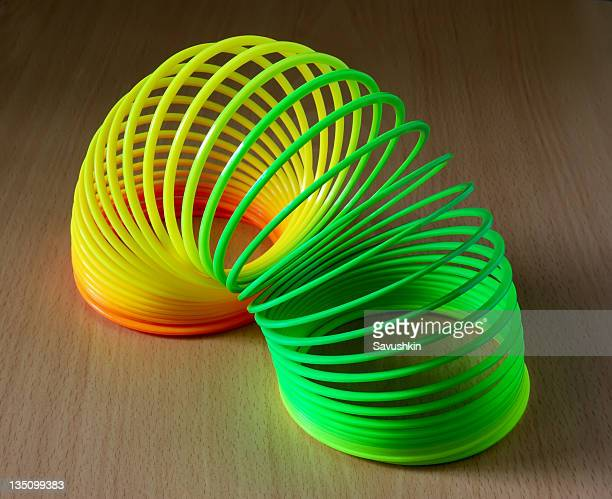 slinky toy - metal coil toy stock photos and pictures
