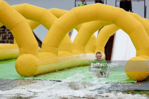 slip and slide - endurance race stock pictures, royalty-free photos & images