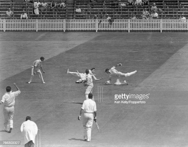 Slip fielder Jackie van Geloven of Leicestershire dives to his left to catch the ball between thumb and forefinger to dismiss Warwickshire batsman...