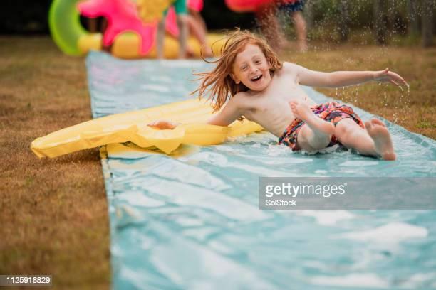 スリップ 'n' スライドの楽しみ - 滑る ストックフォトと画像