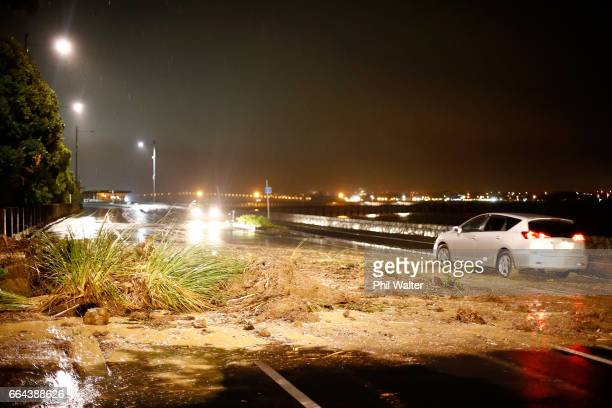 A slip partially blocks Tamaki Drive on April 4 2017 in Auckland New Zealand Torrential rain has hit the North Island as the remants of Cyclone...
