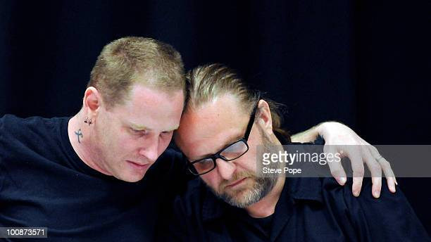 Slipknot lead singer Corey Taylor and percussionist Shawn Clown Crahan react during a news conference on the death of the band's bassist Paul Gray...