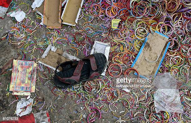 A slipper and broken bangles litter in one of the sites of