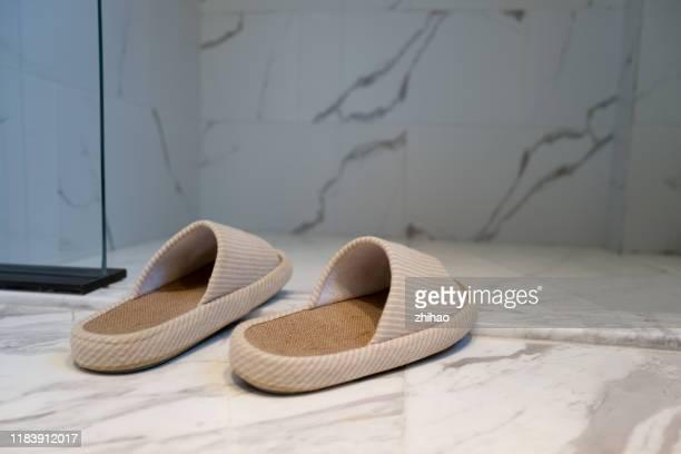 slippers at the door of the bathroom - スリッパ ストックフォトと画像