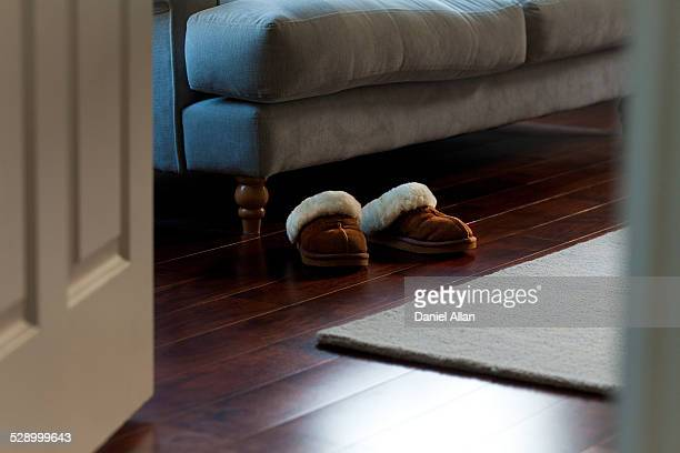 Slippers by sofa