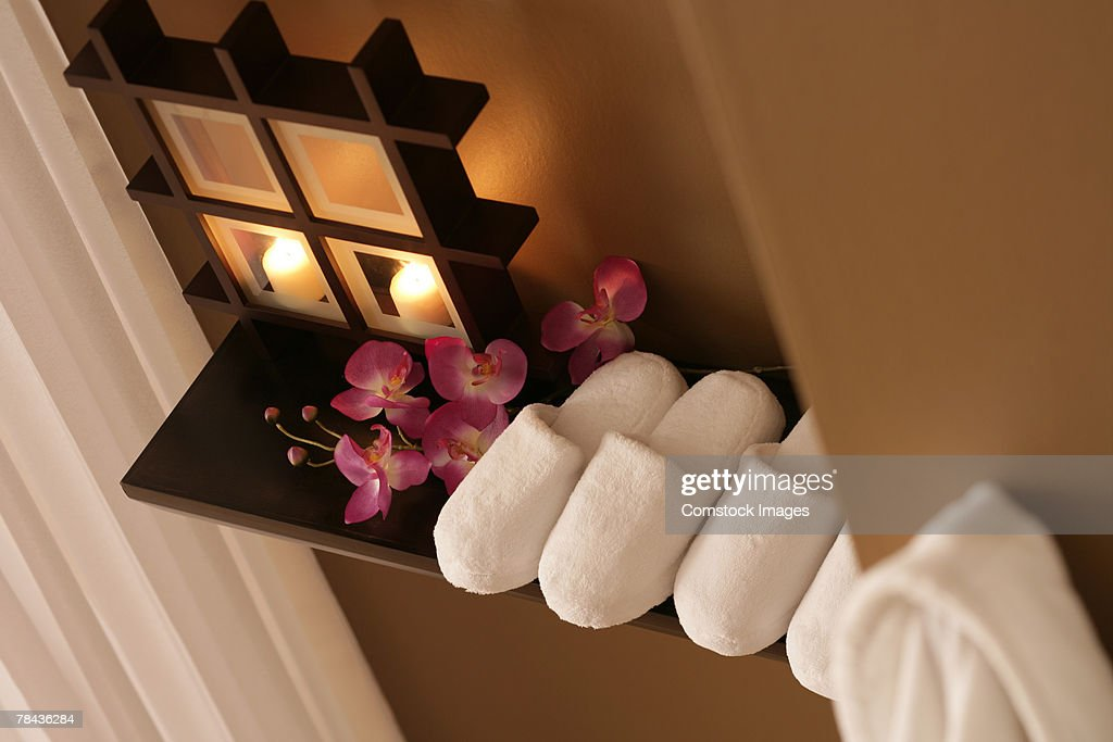Slippers, flowers, and candles : Stockfoto