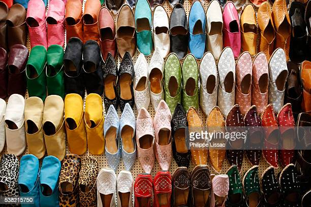 slippers in a shop in the tunis medina - tunis stock pictures, royalty-free photos & images