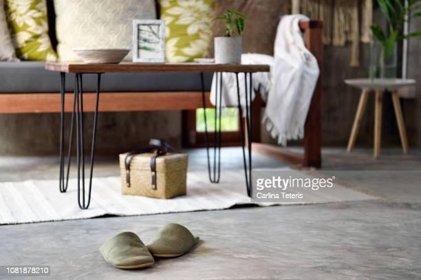 slippers on concrete floor of a stylish living room - スリッパ ストックフォトと画像