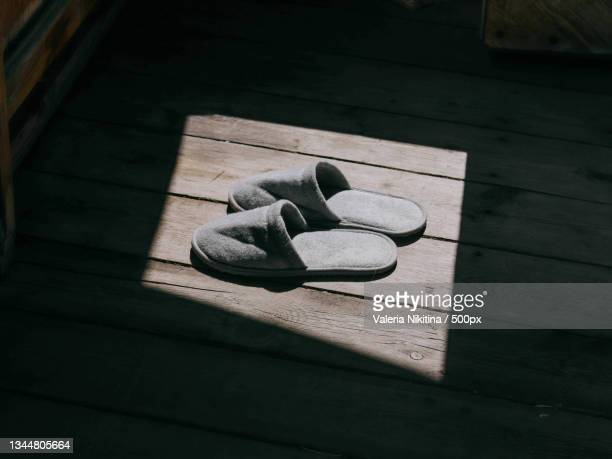 slippers on floor in sunlight,russia - nikitina stock pictures, royalty-free photos & images