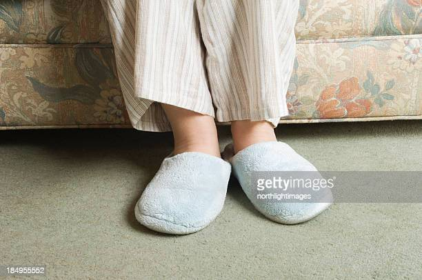 slippers - old women in pantyhose stock photos and pictures