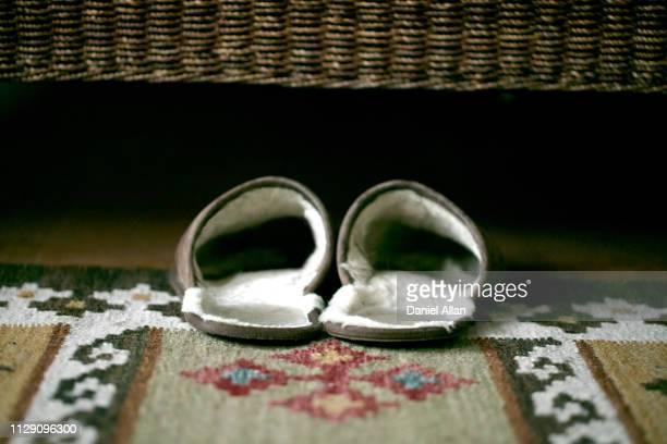 slippers under bed - スリッパ ストックフォトと画像
