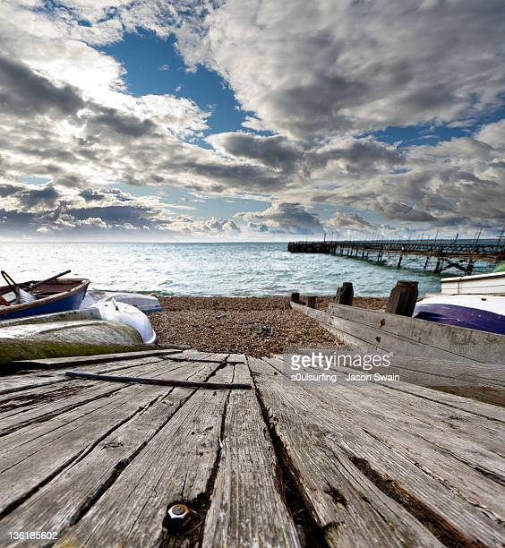 slipway and boat on beach - s0ulsurfing stock pictures, royalty-free photos & images