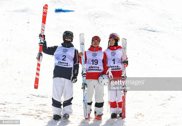 Sliver medalist Benjamin Cavet of France gold medalist Ikuma Horishima of Japan and bronze medalist Mikael Kingsbury of Canada pose following the...