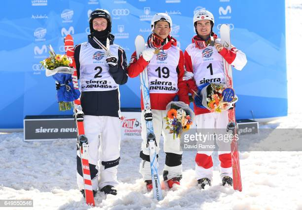 Sliver medalist Benjamin Cavet of France gold medalist Ikuma Horishima of Japan and bronze medalist Mikael Kingsbury of Canada pose during the medal...