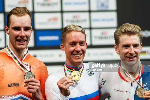 Sliver medalist Netherland's Jan Willem Van Schip Gold medalist Australian Cameron Meyer and Bronze medalist Britton Mark Stweart pose on the podium...