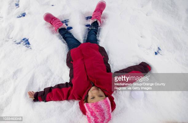 Sloan Osterfeld gets to make a snow angel, just like the ones she's seen in movies and on TV, during the Polar Bear Plunge event at the Sierra...