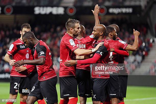 Sloan Privat of Guingamp celebrates with teammates the first goal during the Ligue 1 match between EA Guingamp and Lille OCS at Stade du Roudourou on...