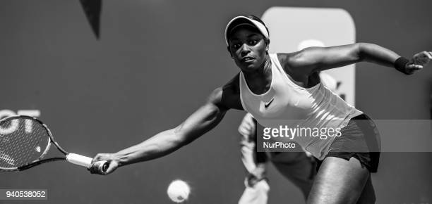 This image has been converted to black and white Sloan Stephens from the USA in action against Jelena Ostapenko from Latvia during the Miami Open...