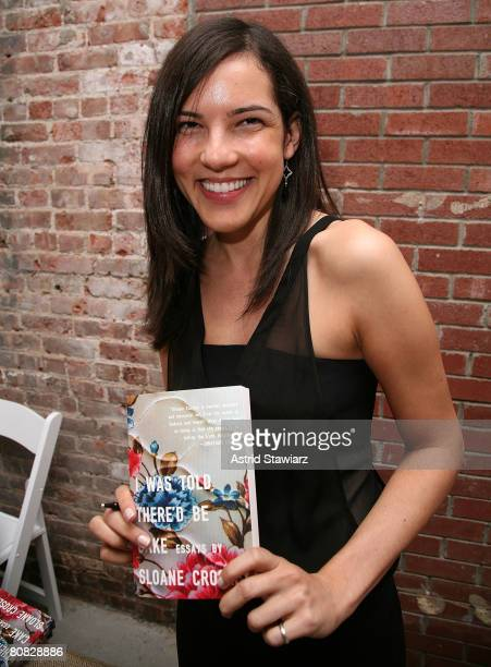 """Sloane Crosley poses with her book """" I Was Told There'd Be Cake"""" at Helmet Lang on April 22, 2008 in New York City."""