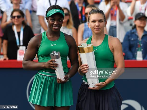 Sloane Stephens and Simona Halep of Romania hold their trophies after competing in the final round during day seven of the Rogers Cup at IGA Stadium...