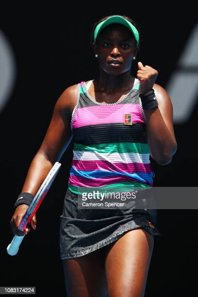 Sloane Stephens of the United States celebrates after winning match point in her second round match against Timea Babos of Hungary during day three...