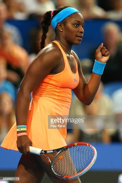 Sloane Stephens of the United States celebrates defeating Alize Cornet of France in the women's singles match during day five of the Hopman Cup at...