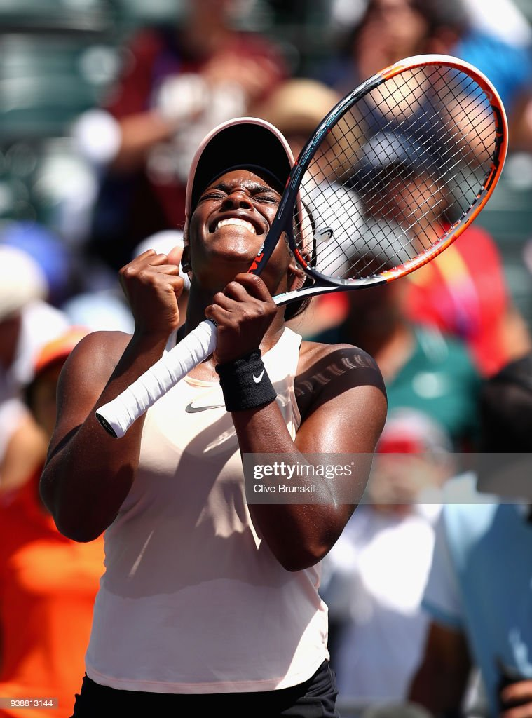 Sloane Stephens of the United States celebrates her straight sets victory against Angelique Kerber of Germany in their fourth round match during the Miami Open Presented by Itau at Crandon Park Tennis Center on March 27, 2018 in Key Biscayne, Florida.