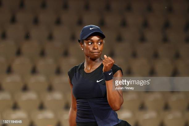 Sloane Stephens of The United States celebrates in their ladies first round match against Carla Suarez Navarro of Spain during day three of the 2021...