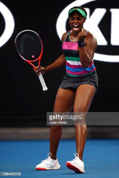 Sloane Stephens of the United States celebrates winning the the first set in her third round match against Petra Martic of Croatia during day five of...