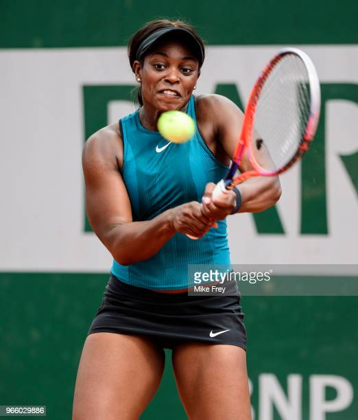 Sloane Stephens of the United States hits a backhand to Camila Giorgi of Italy in the third round of the women's singles during the French Open at...