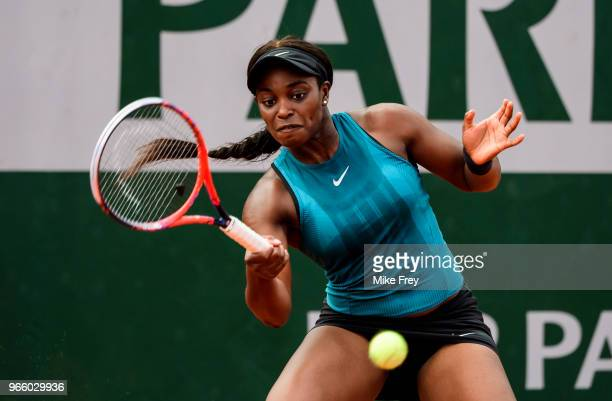 Sloane Stephens of the United States hits a forehand to Camila Giorgi of Italy in the third round of the women's singles during the French Open at...
