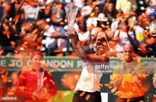 Sloane Stephens of the United States holds aloft the Miami Open trophy after her straight sets victory against Jelena Ostapenko of Latvia in the...