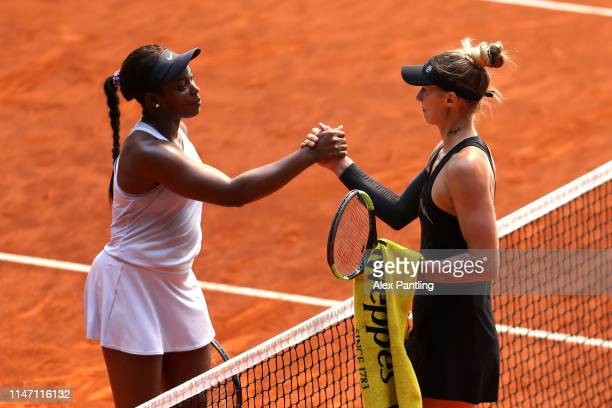 Sloane Stephens of The United States is congratulated on victory by Polona Hercog of Slovenia during day two of the Mutua Madrid Open at La Caja...