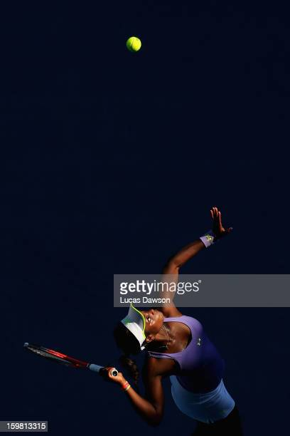Sloane Stephens of the United States of America serves in her fourth round match against Bojana Jovanovski of Serbia during day eight of the 2013...