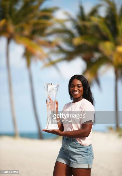Sloane Stephens of the United States on Crandon Park Beach with the Miami Open trophy after her straight sets victory against Jelena Ostapenko of...