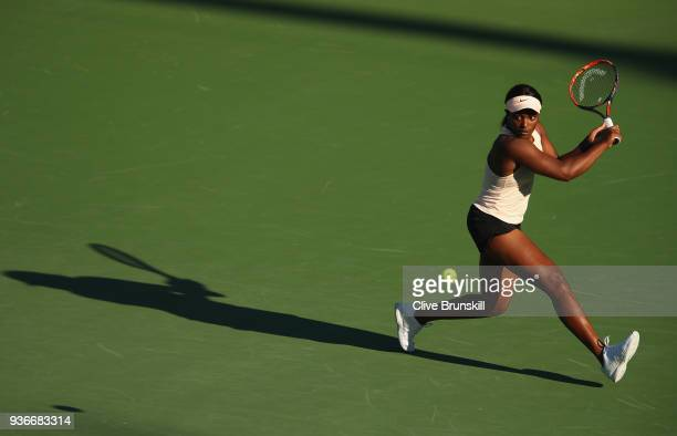 Sloane Stephens of the United States plays a backhand against Ajla Tomljanovic of Australia in their second round match during the Miami Open...