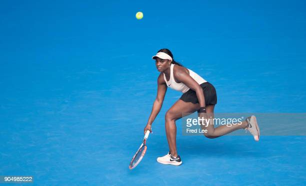Sloane Stephens of the United States plays a forehand in her first round match against Shuai Zhang of China on day one of the 2018 Australian Open at...
