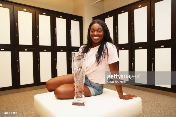 Sloane Stephens of the United States poses for a photo in the locker room with the Miami Open trophy after her straight sets victory against Jelena...