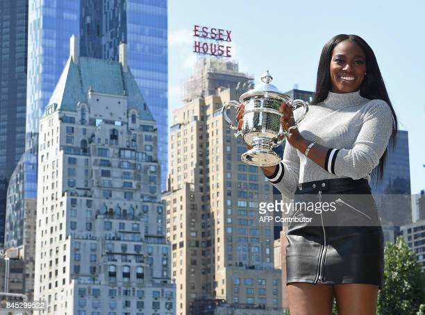 Sloane Stephens of the United States poses with her championship trophy in Central Park in New York on September 10 the morning after defeating...